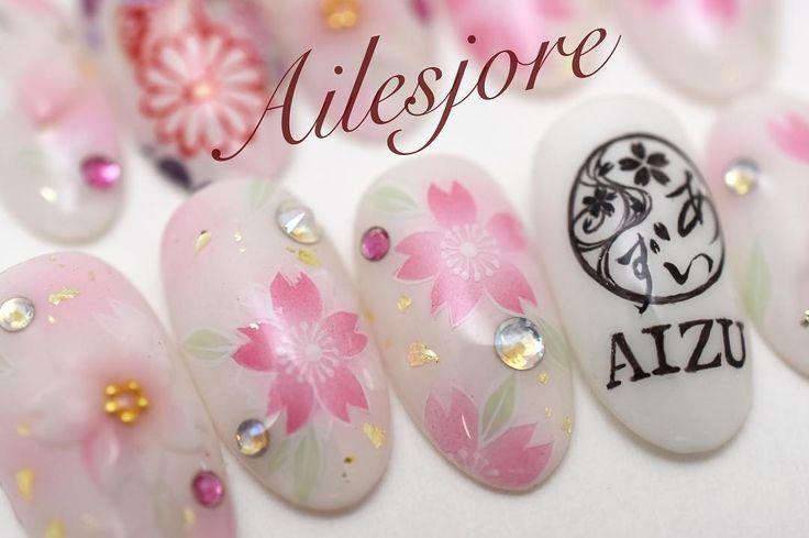 AIZUロゴ 先ほどリポストさせて頂いたネイルチップ AIZUマレーシアの 1周年記念の浴衣パーティー用  浴衣に合わせて エアブラシでベース AIZUロゴ鞠桜の縁取りなどは全て 手書きで 桜の3Dも添えて  AIZUのロゴも桜が入っていて可愛いです (ω)  Ailesjore 本厚木 エルジョワ  #gel #Instanails #nails #fashionnails #Ailesjore #ongles #onglesengel #Japan #airbrush #handmade #logo #本厚木 #本厚木ネイルサロン  #渋沢 #海老名 #小田原 #エルジョワ #ジェルネイル  #センス  #光療美甲 #和柄 #ネイルチップ #swarovski #ネイルブック #kimono #yukata #japanesepattern #aizumalaysia #sakura #AIZU_1stAnniversary