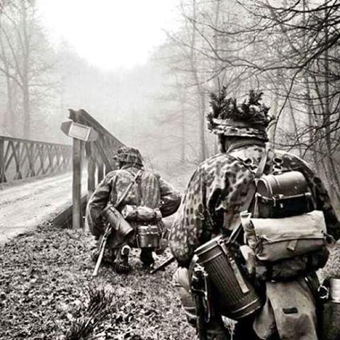 Waffen SS soldiers, near a bridge.