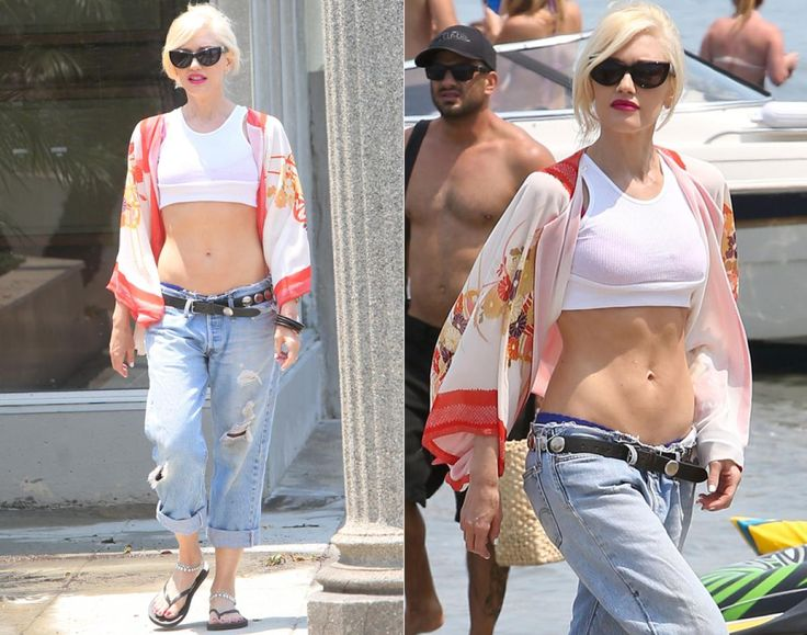 """She may be 43 years old, but Gwen Stefani still has some of the best abs in the business! The """"No Doubt"""" singer showed off her incredibly toned midriff in a white crop top and low rise jeans while spending the day with her two sons in Long Beach, Calif. on  June 29, 2013."""