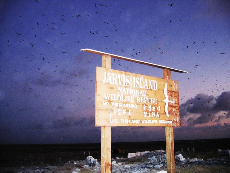 The Jarvis Island sign at dusk.