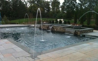 French Pattern #GranitePaving used around a pool. The #Bluestone Coping has been used to create a highlighted border around the pool