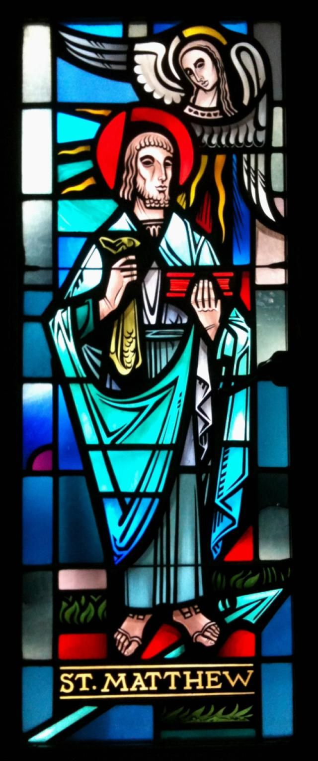 Saint Matthew, Apostle and Evangelist: A stained-glass window of Saint Matthew, Apostle and Evangelist, in Saint Peter's Cathedral, Rockford, Illinois.
