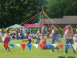 An English Summer Fete, maypole dancing