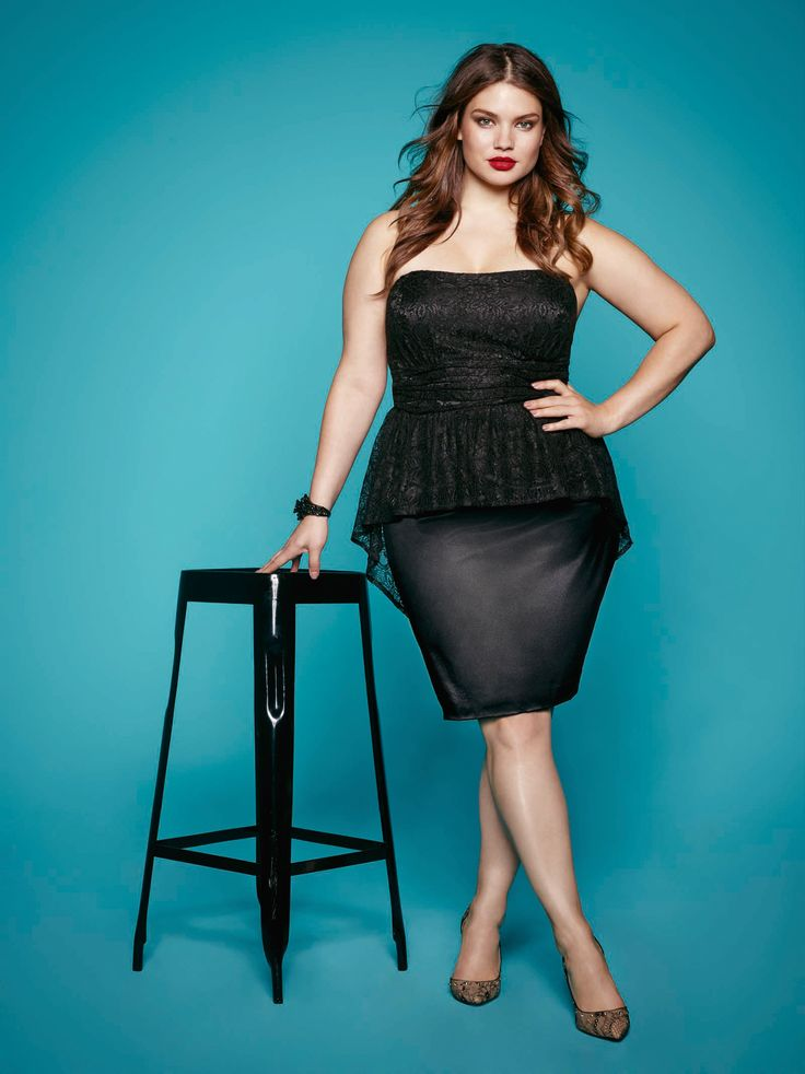 Plus size model Tara Lynn wearing the sexy lace peplum dress. Available at Addition Elle.