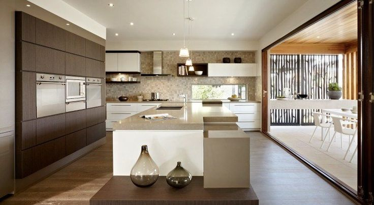 The very stylish Kitchen at the Regency, features Caesarstone beanchtops and a large walk in pantry and overlooking the alfresco area