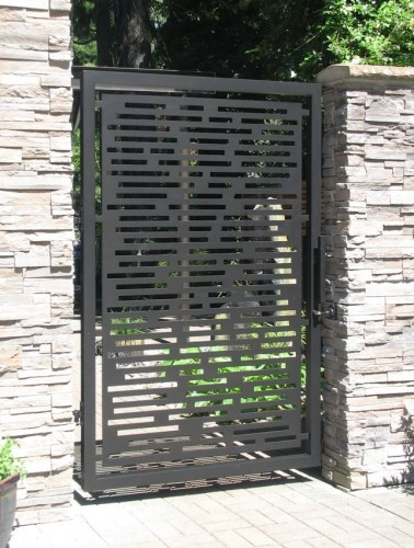 metal gate and stacked brick posts -- beautiful entrance to a not-so-secret garden