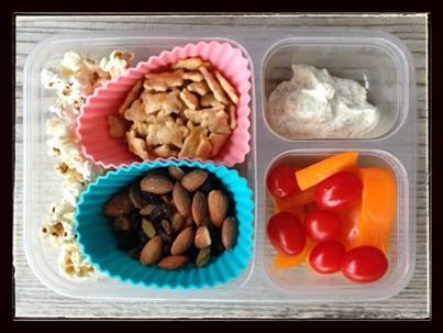 "This is what both my girls got for lunch today (and since I had lunch with them at school I can report that they both enjoyed it!): Tomatoes and orange bell peppers with homemade ranch dip, trail mix (roasted almonds, regular raisins, golden raisins), cheddar bunnies (these are not 100% whole grain so an occasional ""treat"" at our house), and organic popcorn."