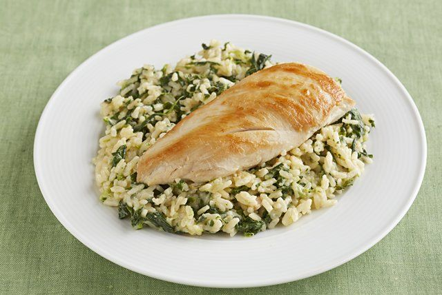 The rice in this chicken and rice recipe is cooked in condensed cream of chicken soup with a dash of nutmeg before being mixed with spinach and cheese.