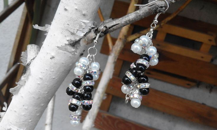 An earring pair of a lot black and white beads.