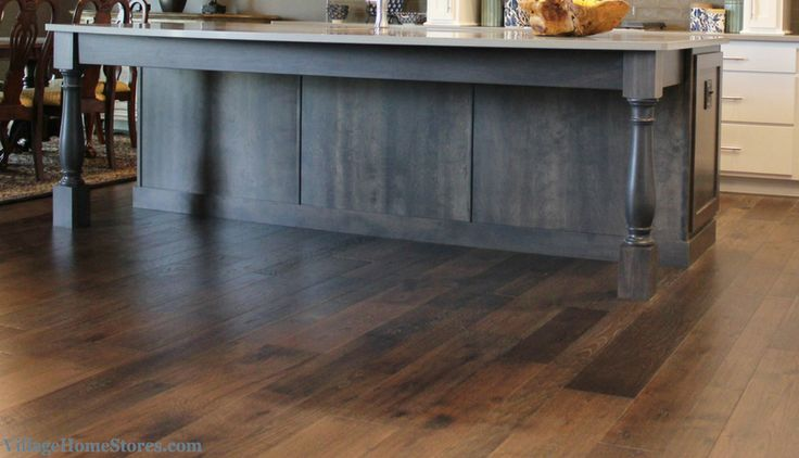 Hallmark hickory flooring in a kitchen including gray stained cabinetry. Kitchen design and materials by Village Home Stores for Tim Dolan Development. | VillageHomeStores.com