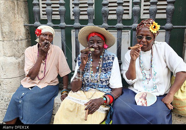 Brunettes Women Smoking Cigars Black Woman Representative To The Stock Photo, Picture And Royalty Free Image. Pic. 61178710