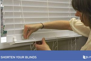 If your horizontal wood or faux wood blinds are too tall for your window frame, you may be able to shorten them yourself. All you need for this quick DIY is a pair of scissors! This how to shorten bl