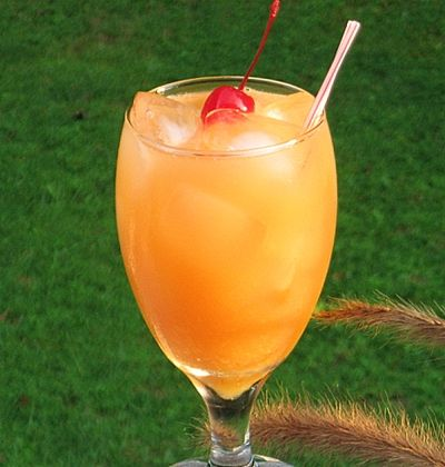 Sex on the Beach  (2 oz. Vodka  2 oz. Peach Schnapps  2 oz. Orange Juice  2 oz. Cranberry Juice  Cherry for garnish)