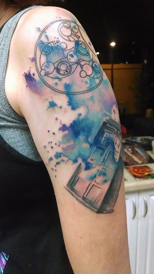 "Doctor Who tattoo done at Art Junkies in Hesperia CA by artist Brent Olson. Watercolor Tardis and circular Galifreyan that reads ""G..."