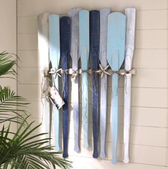 Remember the Oars Headboard? This is a great way to hang oars and turn them into wall art. You can have a lot of fun Painting the Oars in different colors too.  JoAnn Crafts
