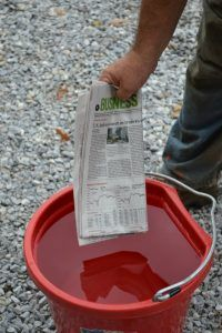 Dip several sections of newspaper in a bucket of water.