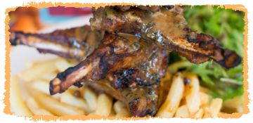Lamb Cutlets served with a scrumptious sauce, golden fries and crisp garden salad.