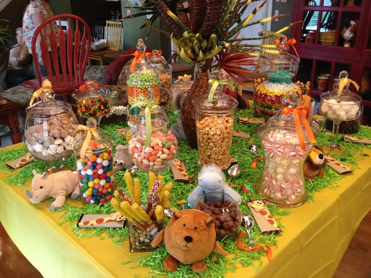 I was really pleased with the candy buffet. It's amazing how using different sized candy jars, candies in different shapes, colors, textures and sizes, confetti, stuffed jungle animals and some colorful ribbons on the jars made the table come to life!