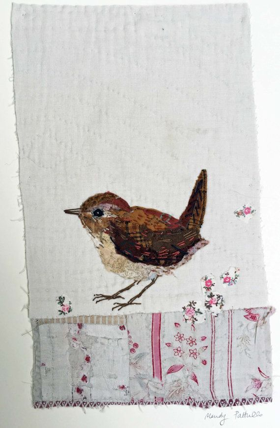 I treasure the old and worn and refashion them into little textile collages in my attic studio in a converted manse in Northumberland, England. Everything I make is individual and unique. This little wren is hand appliquéd and embroidered on to a support of an old patchwork quilt fragment. A second piece of very worn out quilt, mid Victorian, has been attached to the bottom half because of its interesting texture and print. The collage is then sewn on to a piece of mount board to make it…