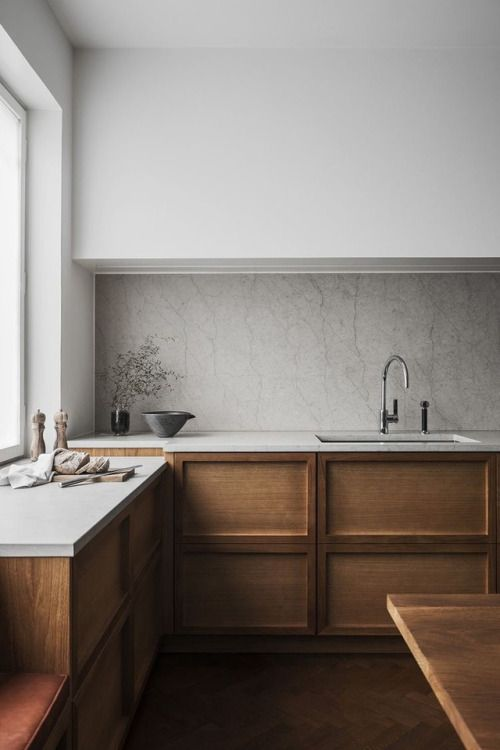 Wood cabinets look fresh next to countertop, backsplash and white uppers.
