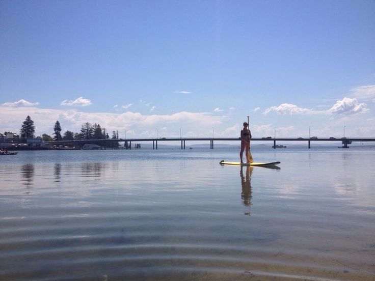Stand up paddle boarding on the calm Tuggerah Lakes at The Entrance. #theentrance #calm #standuppaddleboards #seeaustralia