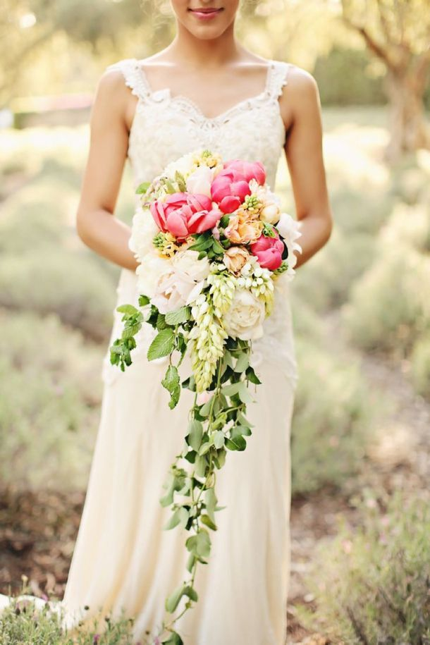 Cascade Bouquets are a top wedding trend for 2014. The perfect bouquet choice for a bride with a simple dress! #wedding #bouquet #cascade #flowers #beautiful