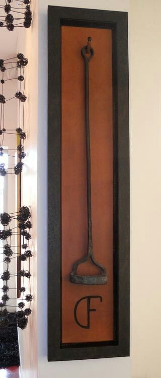 http://www.metroframeworks.com/amazing-art-framing-in-denver/shadow-boxes/  nice way to display branding irons
