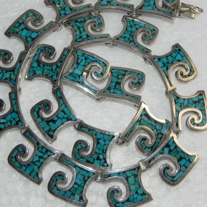 De stijl van de Navajo turquoise ketting 925 zilveren 94.16g  De stijl van de Navajo turquoise ketting 925 zilveren 94.16gGrote voorwaarde - ketting 41cmTurquoise steen925 zilverenVerzekerde verzending  EUR 1.00  Meer informatie