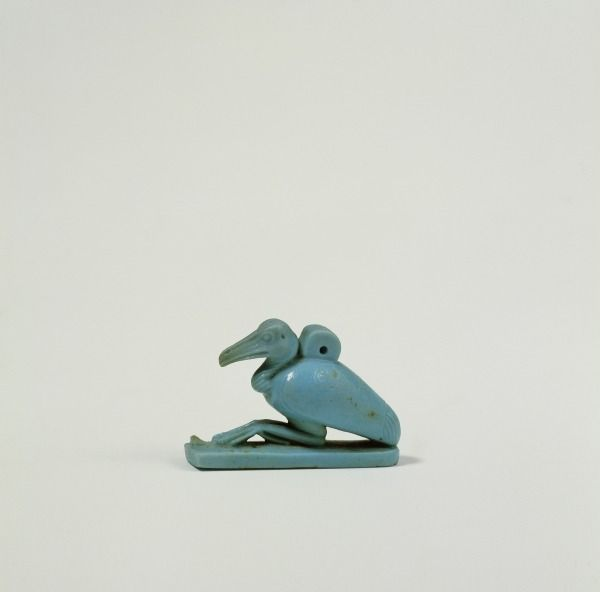 Amulet of the Ibis of Thoth. Late Period, 26th Dynasty, (664-525 BC). Faience, 2.7 x 3.8 cms.