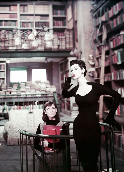 This portrays so much. One of the most classic faces of film in the 1950's and 1960's looks small and unimportant compared to a painted, dolled-up model. It shows that the most painted faces aren't the most beautiful.  Audrey Hepburn and Dovima, Funny Face 1957