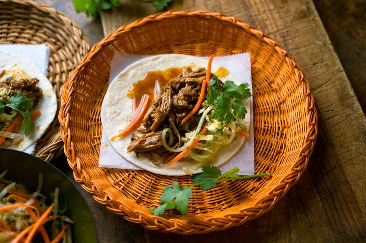 Vaguely Vietnamese Slow Cooker Pork Tacos served with a crunchy, spicy slaw and soft flour tortillas. This will yield a terrific dinner for a large crowd, or a small dinner tonight and another tomorrow night and perhaps the night after that. (And it freezes pretty well.)