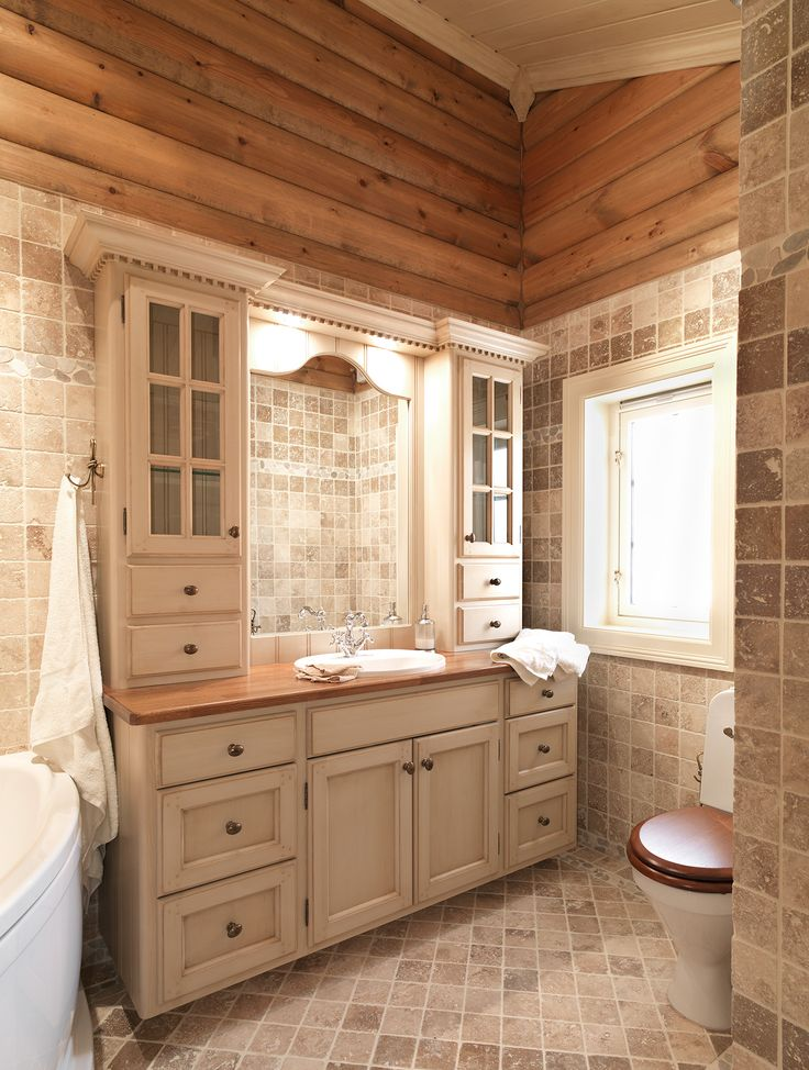 Brightly bathroom furniture with gorgeous wooden details. Worktop in oak, with embedded sink. Handcrafted and hand painted by Os Trekultur.