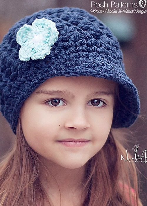 Modern Crochet Flower Pattern : This modern crochet pattern makes an elegant newsboy hat ...