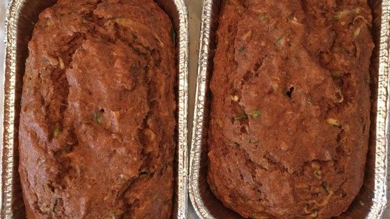 Vegan zucchini and banana bread muffins made with applesauce and vegetable oil are a hearty and delicious way to start the day.