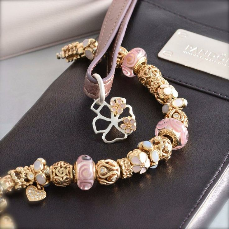 PANDORA Bracelet with Beautiful Gold and Pink.