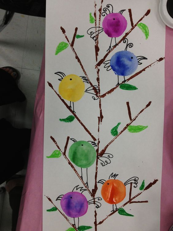 Kinder Birds..Printmake w/cut cardboard for the branches, trace baby bottle lids for the birds & tempera cake them. Add detail with sharpie markers & oil pastels for leaves & grass.: