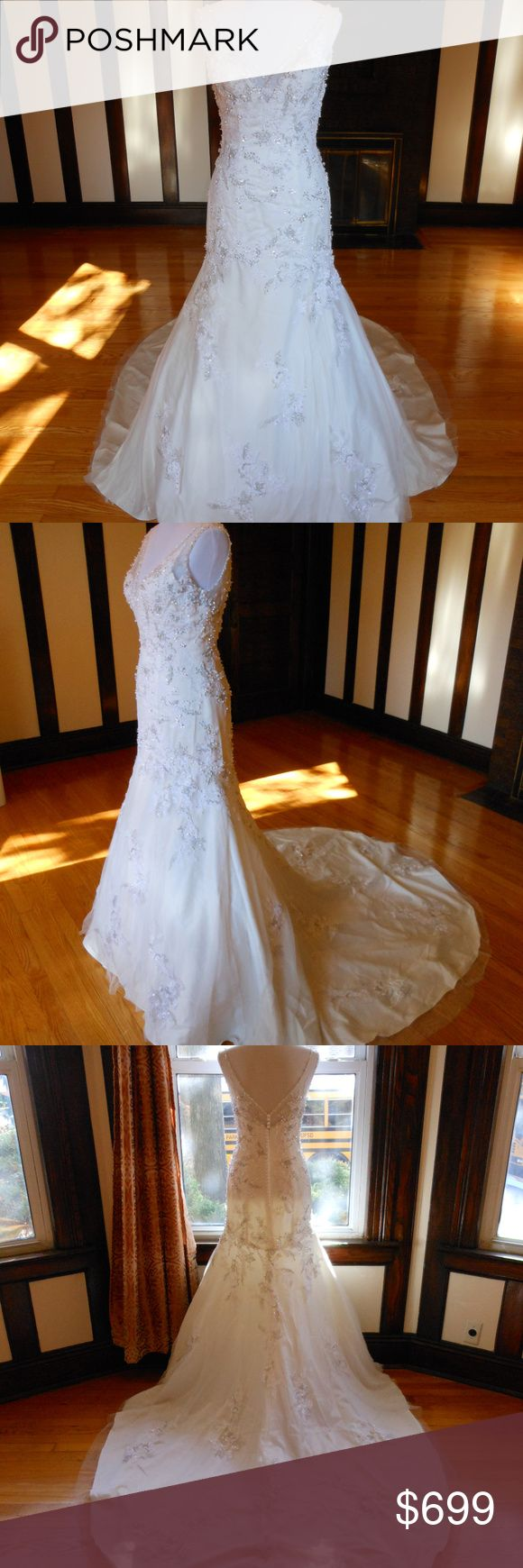 """Justin Alexander Wedding Dress This is an Authentic JUSTIN ALEXANDER Bridal Wedding Dress Gown. It has a gorgeous trumpet style with a fabulous long train. This dress is brand new in great condition with the original label. It was never worn.  Size: 6 Bust: 34"""" Waist: 28"""" Hips: 37""""  Color: Ivory/Silver Justin Alexander Dresses Wedding"""