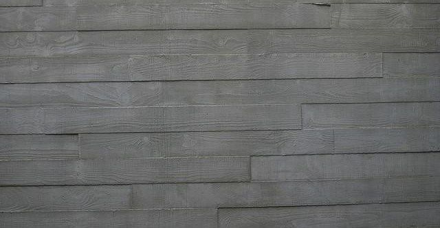 A Board Formed Concrete Wall With Staggered Board