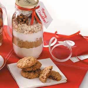 """Spicy Oatmeal Cookie Mix Recipe: """"Brown sugar and spice and everything nice—like cinnamon, coconut, oats and chips—are layered together in pretty jars of yummy, ready-to-bake cookies. A quick and easy gift idea that's appreciated any time of year, it was shared by our Test Kitchen. Remember to include preparation instructions and a list of any additional ingredients needed with your gift tag."""""""