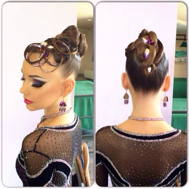 High bun with elaborate swirls and rhinestonned ringlets. Great hairstyle for standard ballroom. Also note the bold yet clean makeup. Visit http://ballroomguide.com/comp/hair_make_up.html for more hair and makeup info