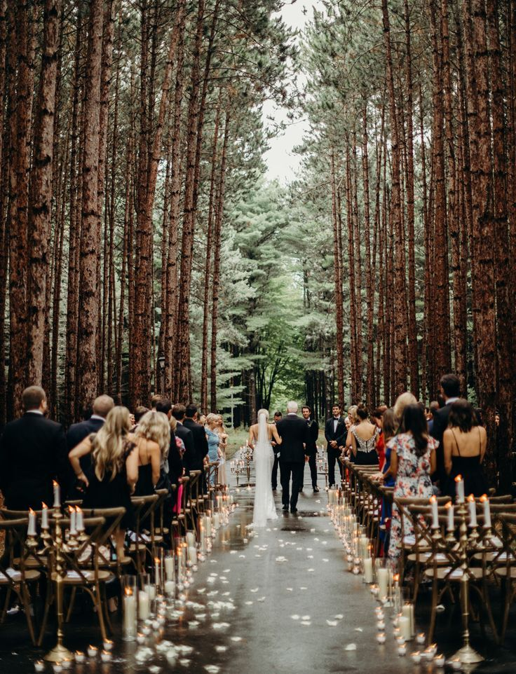 Intimate Torch Lake Wedding in the Woods. Elegant Black Tie Wedding. Aisle lined by Candles.