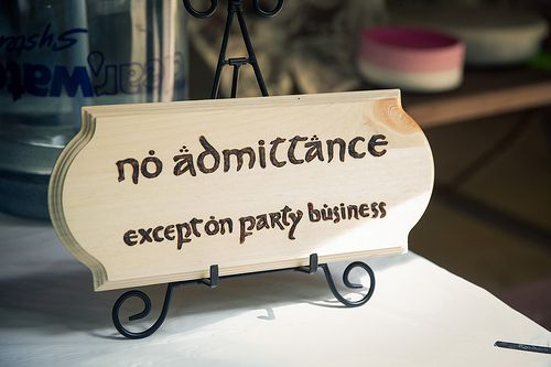 Lauren & Ben's casual double-vowed Lord of the Rings wedding | Offbeat Bride. We need this sign.