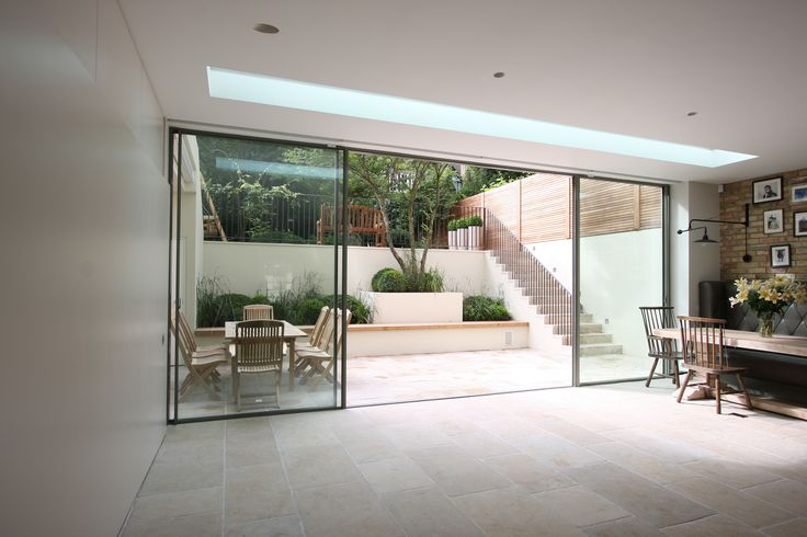Minimal windows as modern patio doors in London by IQ Glass.