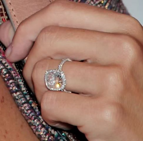 Molly Sims sports one of my all-time favorite engagement rings: It's a large cushion cut solitaire in thicker than usual pave halo setting.