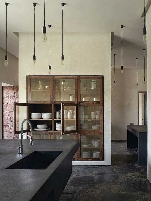 The floor! The cabinets molded into the stone wall. The bench. Perfect
