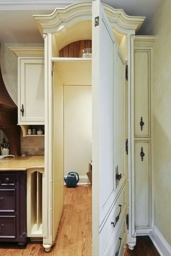 Secret pantry room behind kitchen cupboard pantries for Hidden pantry doors