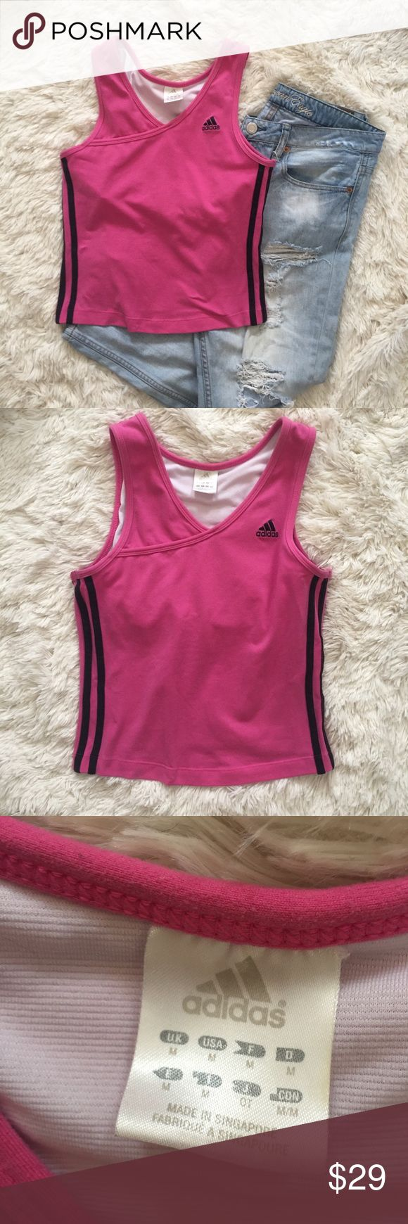 "Adidas hot pink & black crop top size Medium Adidas hot pink crop top with built in sports bra size medium. Gently used condition. Embroidered adaidas logo, stripes down each side. A favorite of many trending celebrities such as Kylie Jenner! Measurements: 15"" pit to pit (stretches), 22"" length. Reasonable offers always accepted. adidas Tops Crop Tops"
