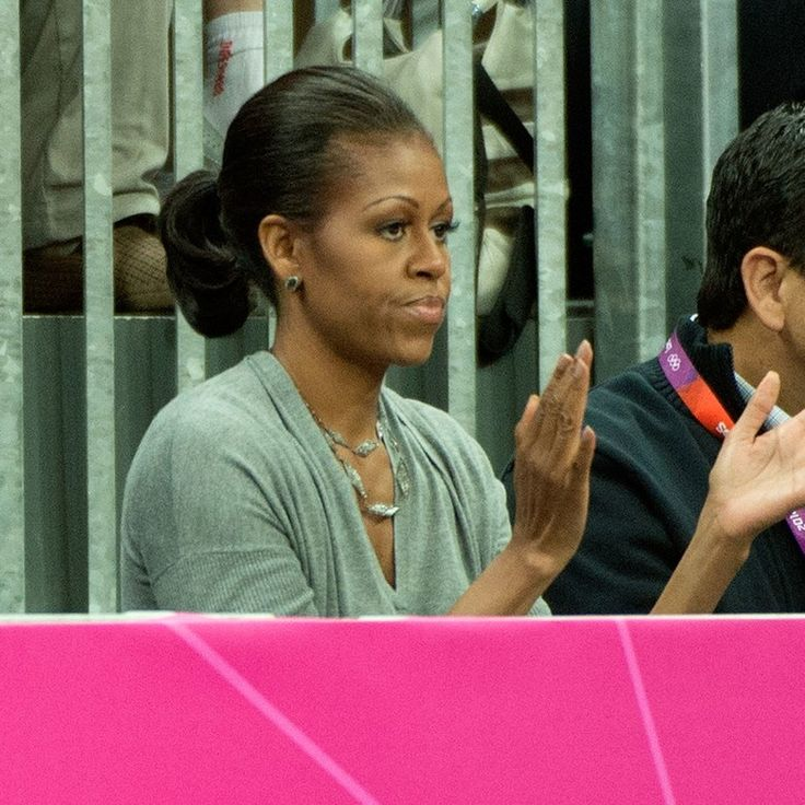During the 2012 Summer Olympics, Michelle wore her hair in a simple ponytail while cheering on Team USA at the USA vs. France basketball game. Ponytails can be practical, fun, and unexpected.