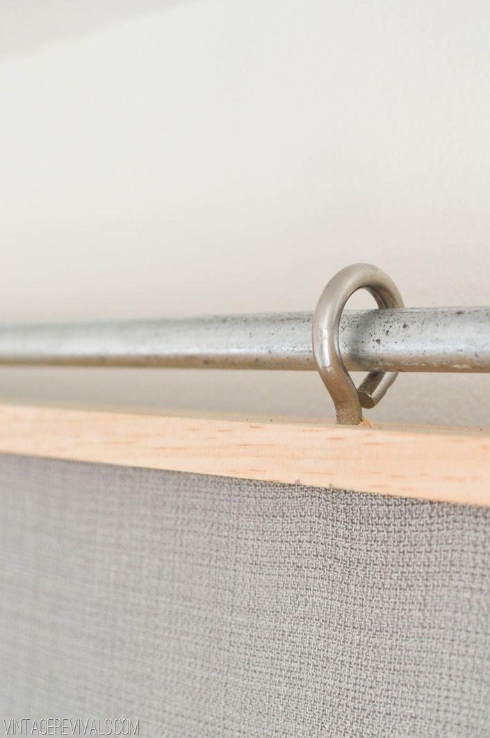 vintagerevivals.com Sliding fabric barn door.  Check out the hardware instructions!