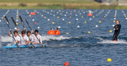 Members of Britain's under-23 rowing team pull a wakeboarder during a display before the canoe sprint events at Eton Dorney during the London 2012 Olympic Games, Aug. 11.  (Photo: Darren Whiteside / Reuters) #NBCOlympics